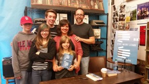My family (L to R): Joshua, Somerset, Calvin, Kristy, Genevieve (holding the book), and me.